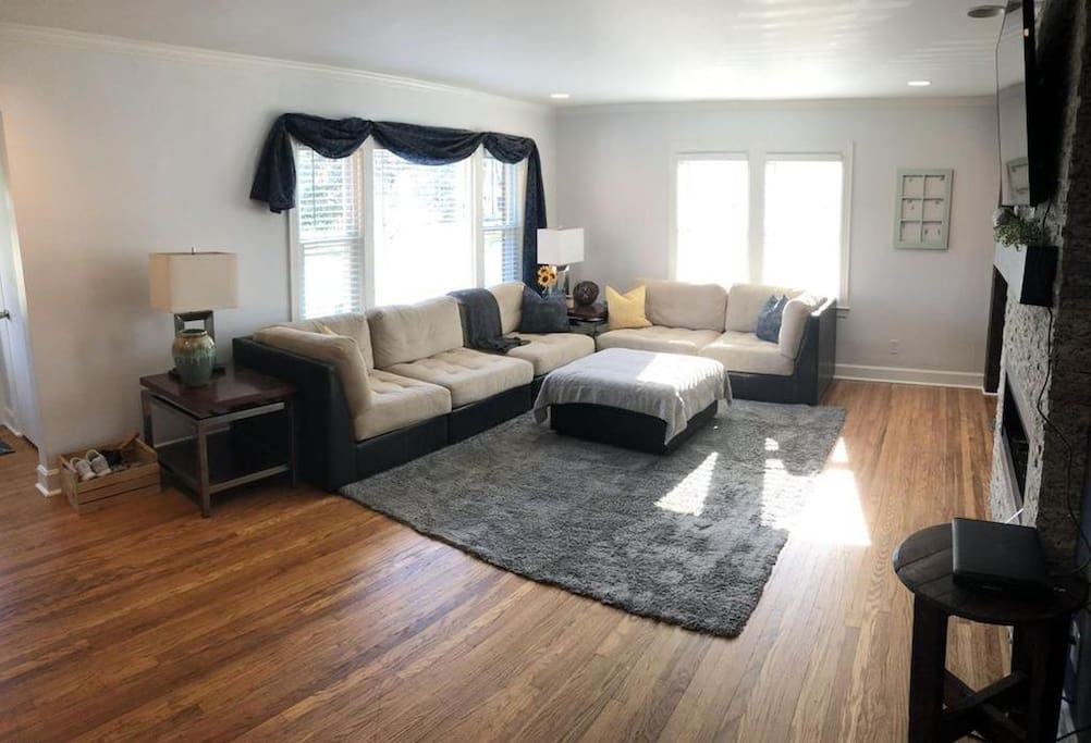 Living room with hardwood floors and large sectional sofa.