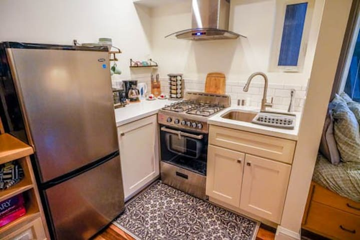 Just remodeled 2/2019 with a wonderful Gas stove/over and room refrig/sink.  Sweet window that looks out to garden.