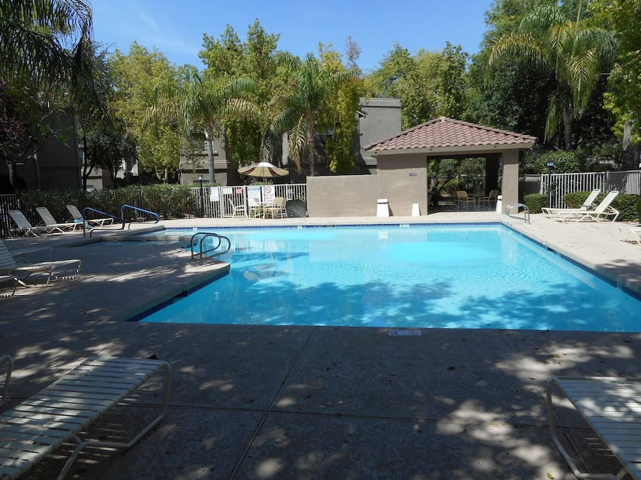 Community pool with plenty of outdoor seating!