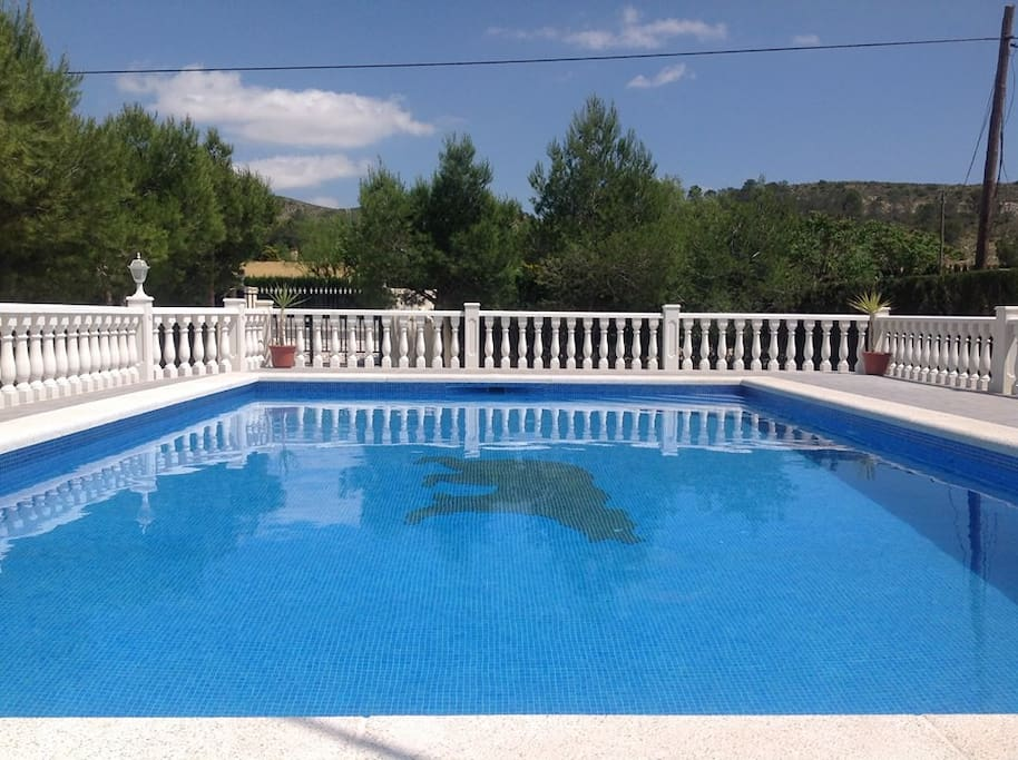 Access to large swimming pool within villa grounds