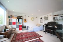 'The Studio'.  With a double sofa bed. With 60inch TV, BluRay/ DVD player. SKY (movies/ boxsets etc), internet, professional digital piano and various toys etc.