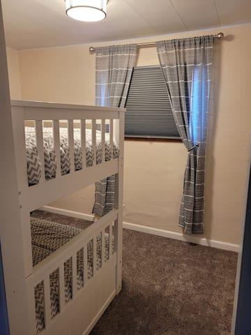 Captured bedroom with bunk beds.
