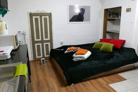 Cozy colorful studio apartment in the city centre