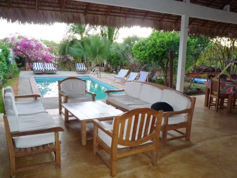 Bungalow with 2 bedrooms in Andilana, with wonderful sea view, shared pool and enclosed garden