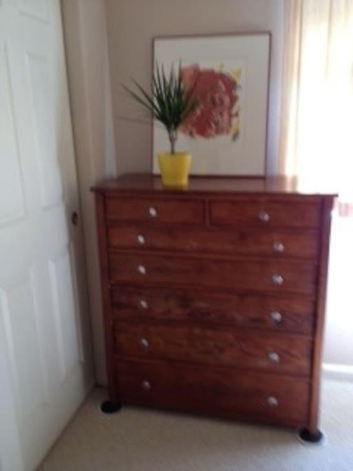 Big antique dresser, next to big closet.