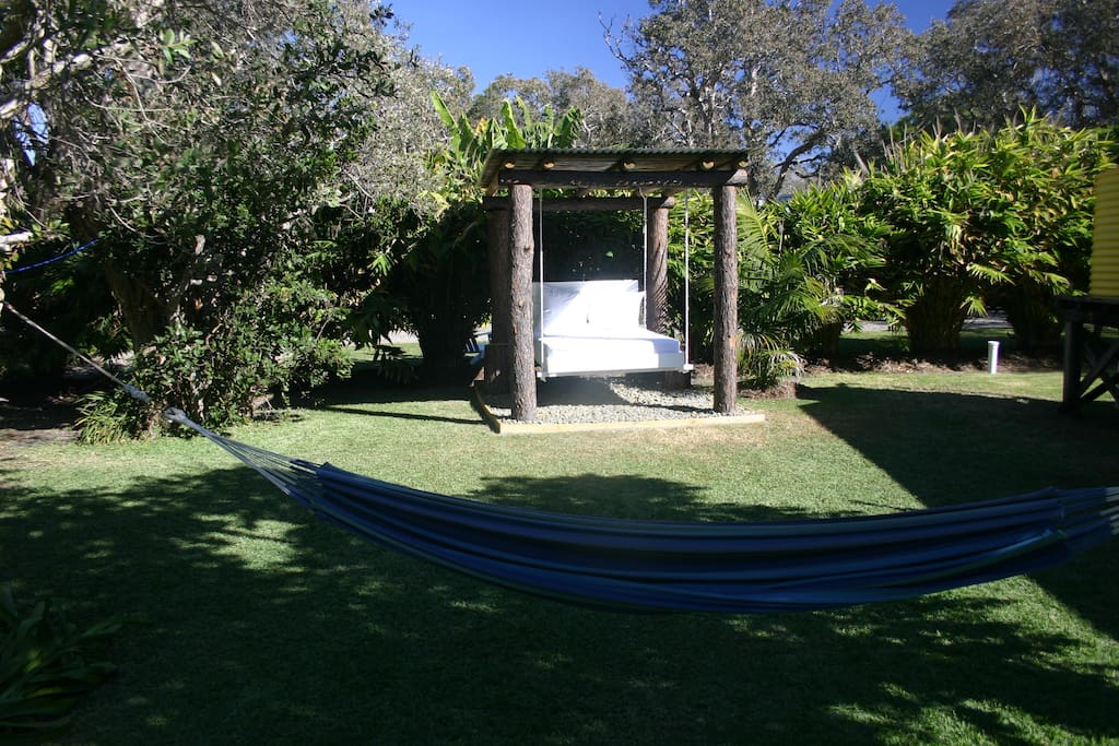 Relax in the daybed or hammock in the tropical gardens