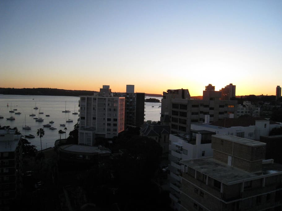 It's a new day and the sun is rising over Sydney Harbour
