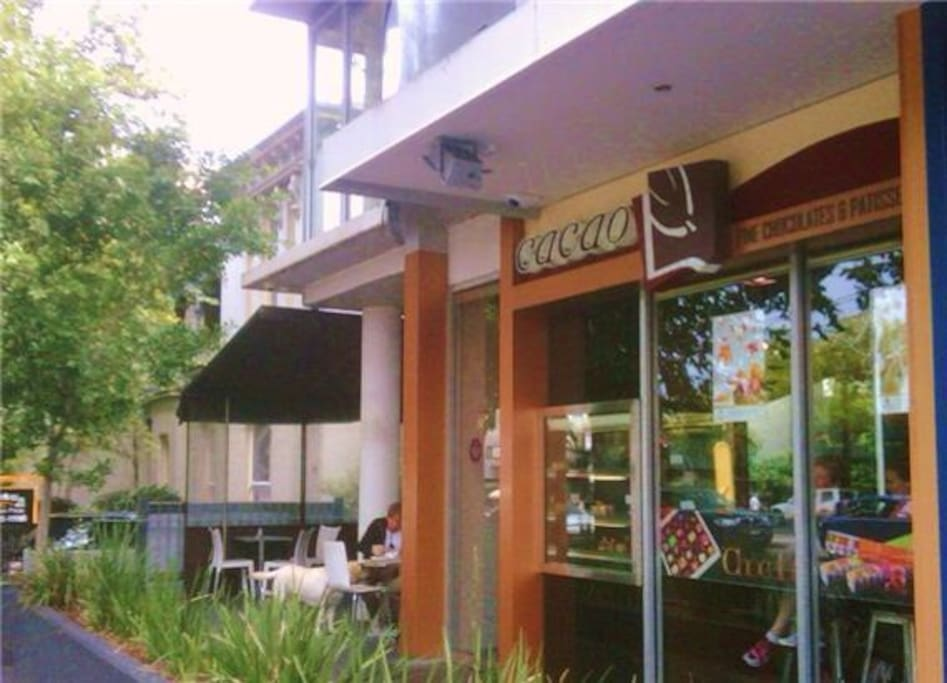 Apartment front. Cacao French cafe at the entrance has great coffee and desserts.