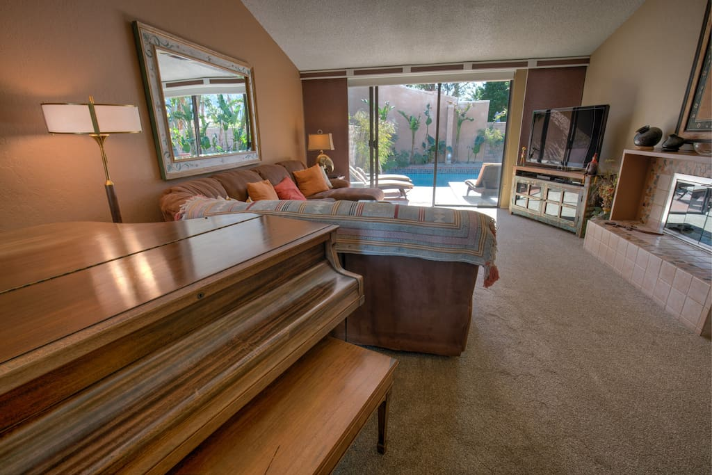New additions in 2018:  plush carpeting in living room and bedrooms, new sliding, textured panels on each window (bye bye folding shutters) and an heirloom  baby grand piano (admire only), plus newly-Gemstone-coated pool & spa. Pride of ownership glows here!
