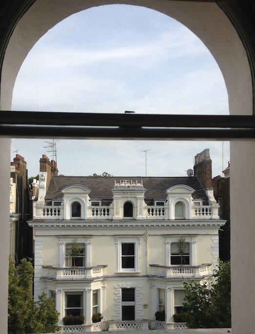 View from the window: grand houses, built as one-family residences in 1870s.