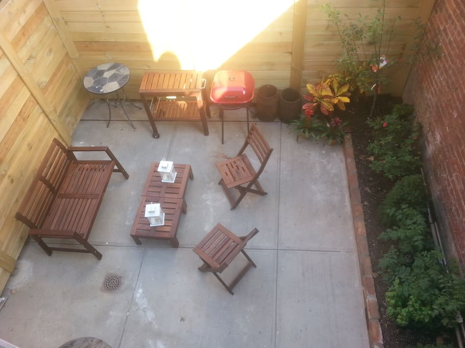 Outdoor Living Room, with nice new furniture and grill.