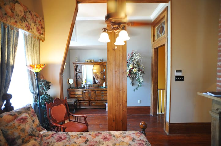 The Garden Suite offers a cozy and private space at the rear of the home.