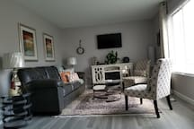 Cozy/ romantic living area with fireplace and  queen size sofa bed. Flat screen with cable and chromecast