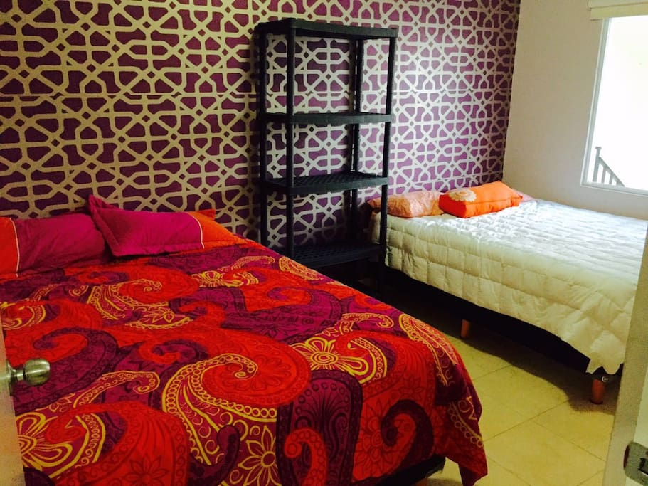 Dormitorio con dos Queen size
