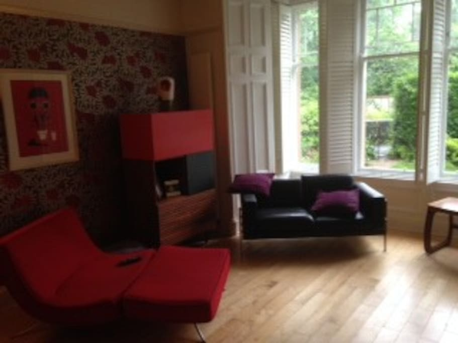 lovely room with living flame fire and views of the garden