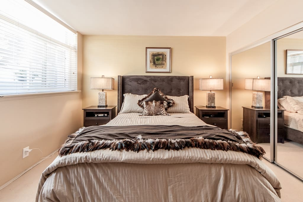 Spacious chic bedroom has queen pillowtop mattress, luxury linens and large mirrored closet.