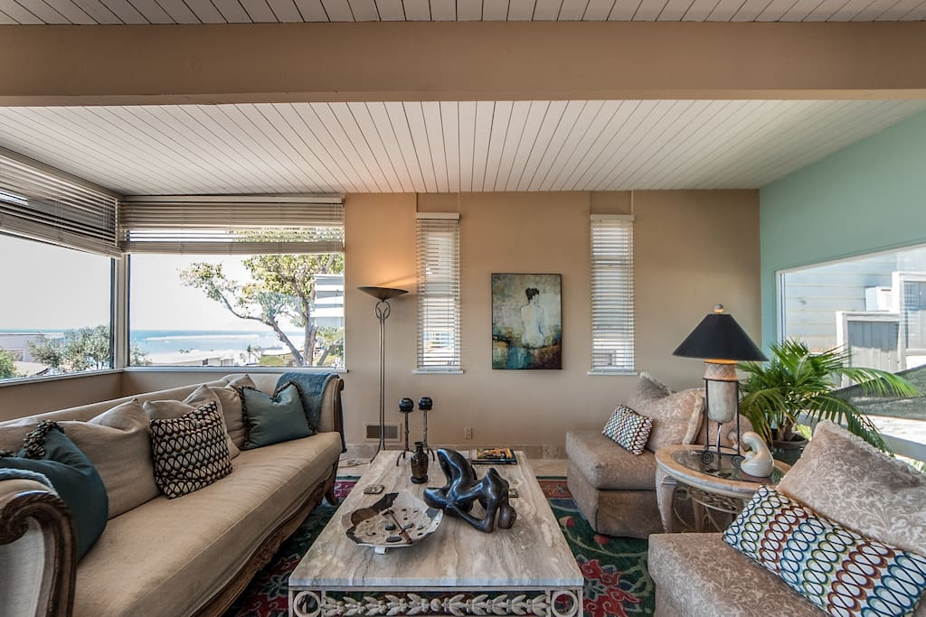 Large luxurious and comfortable living room with fabulous ocean and atrium views.