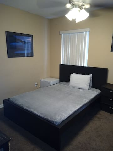 Bedroom with platform bed and smart tv
