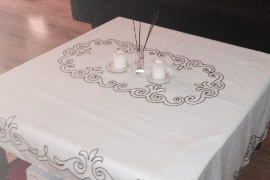Vintage table cloth - also the location of the remote controls