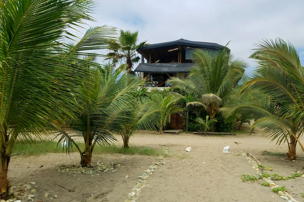 View of La Casa hostel from the beach