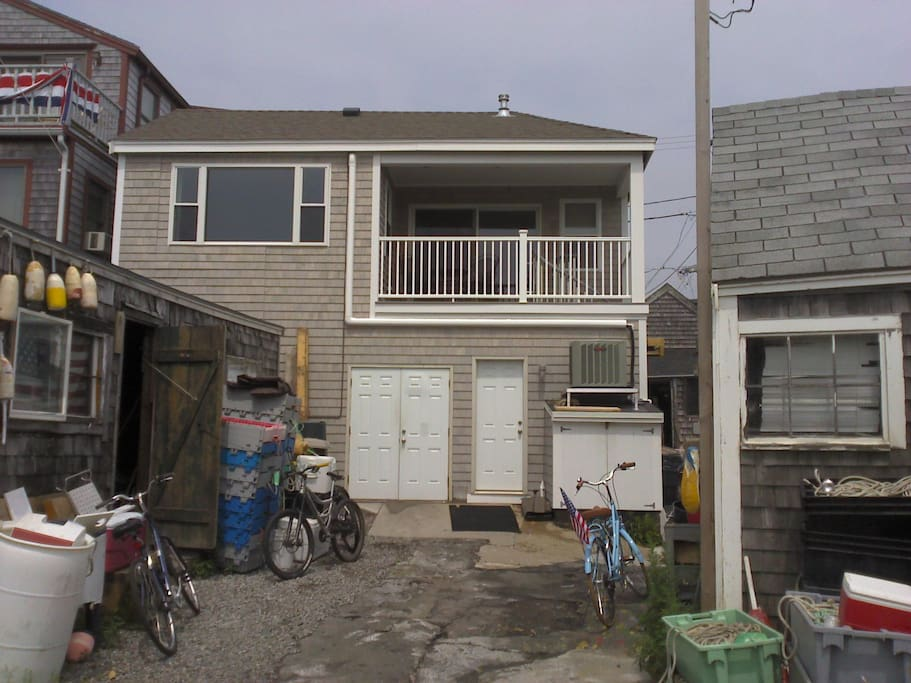 Rear entrance of apartment on Bradley Wharf, lobster shacks near right and left