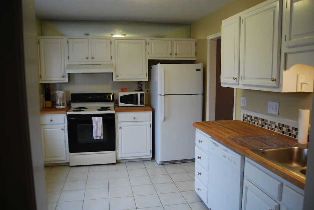 Kitchen with dishwasher, butcher block counters