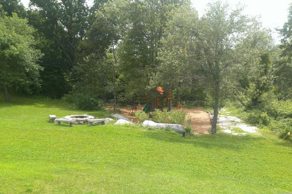 View from back deck; fire pit and swing set
