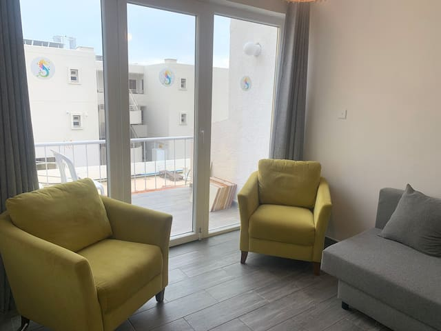 living area with access to the balcony