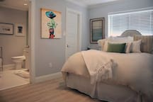 Bedroom with Queen Size bed and private bathroom.