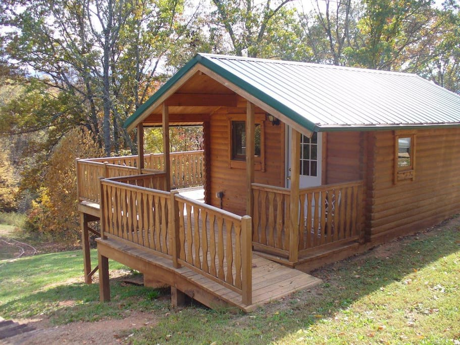 Here is the common kitchen. Note the large outside patio that has a large picnic table. There is a dining table inside also.