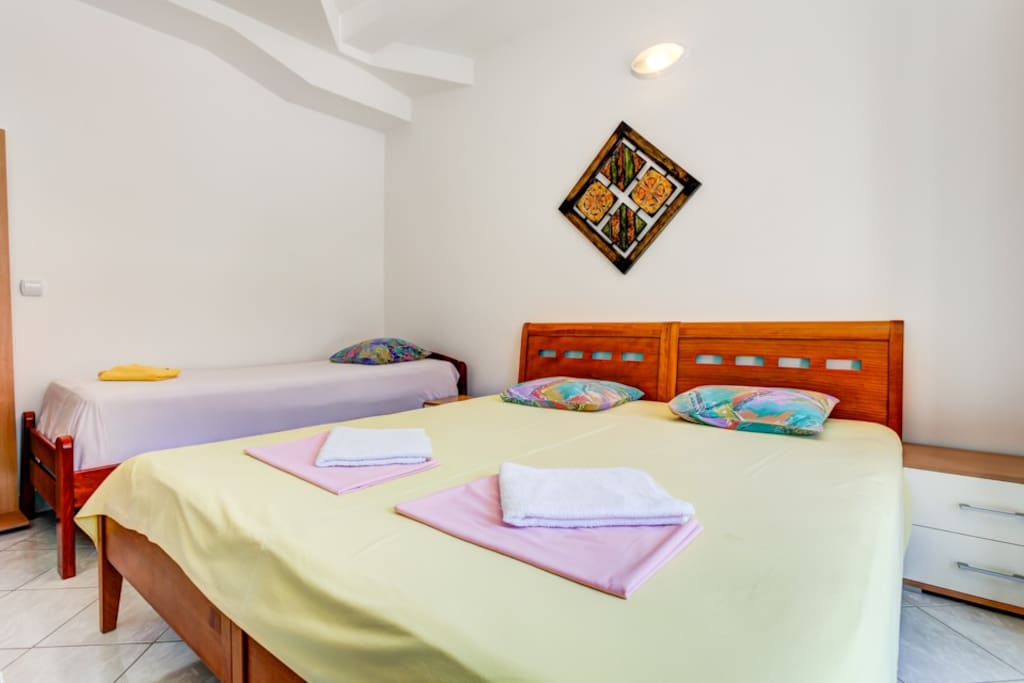 Comfortable double bed with a single next to it, perfect combination for 3 persons.