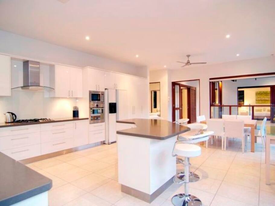 Large open plan kitchen with quality appliances and Nespresso machine and dining