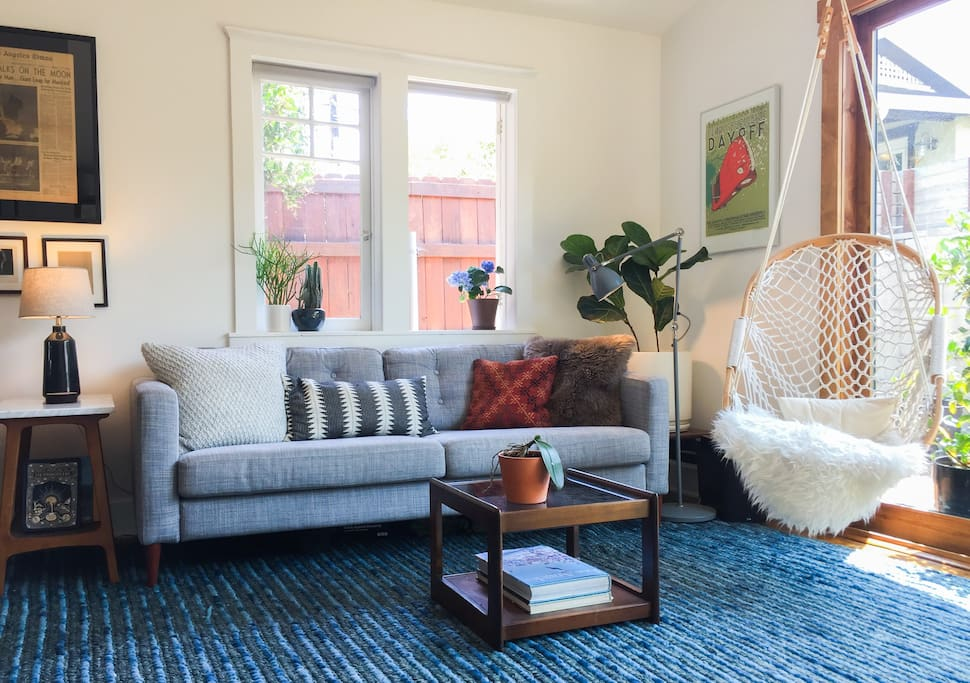 Breezy and bright living room opens up to a private back deck.