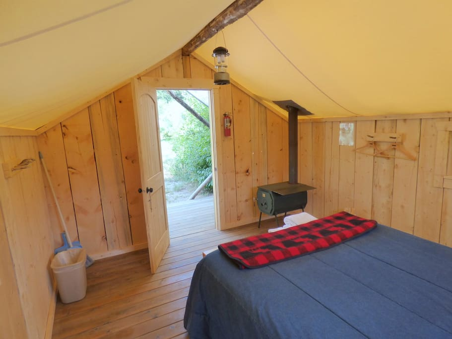 Cozy bedding and wood stove with towels provided. Two Battery operated lanterns and a flash light provided.