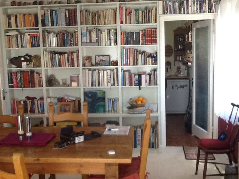 The kitchette is off the living dining room and here you see all the books that are available!