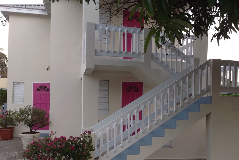 Villa Mia's entrance doors are all painted in that gorgeous Bougainvillea Pink! Our trademark!