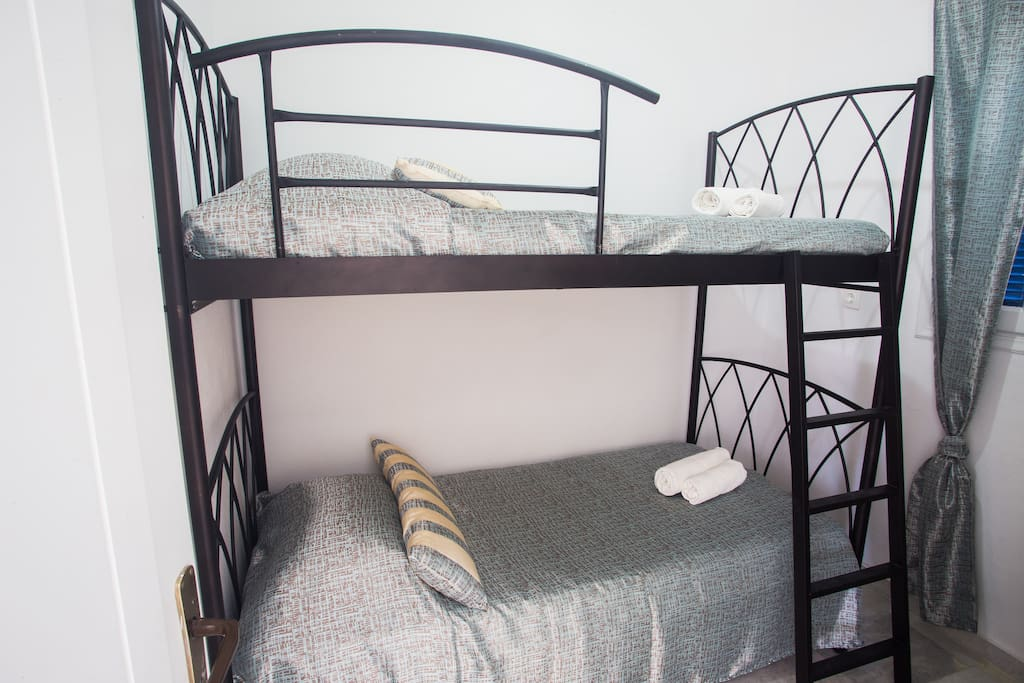 The second bedroom may accommodate two children or two adults. The bunkbed is offered with side safety bars from all three sides.