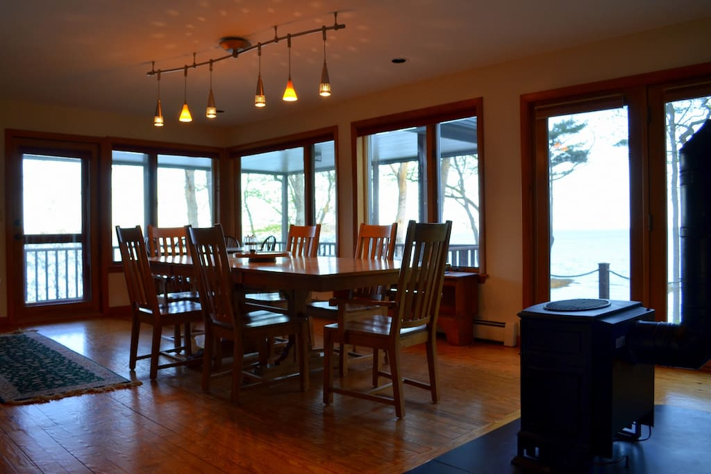 Dining area has a cozy gas fireplace and sweeping ocean views.