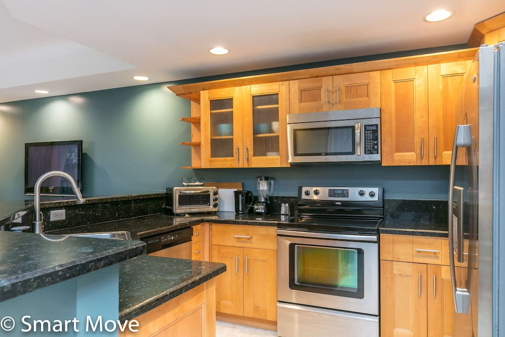 Granite counter-tops with stainless steel appliances