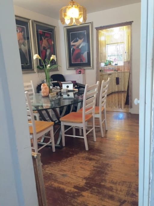 Eclectic original hardwood floors & full dinning room.