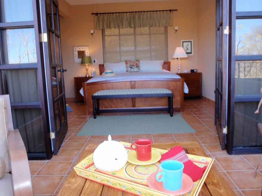 King bedroom with balcony overlooking the Pacific
