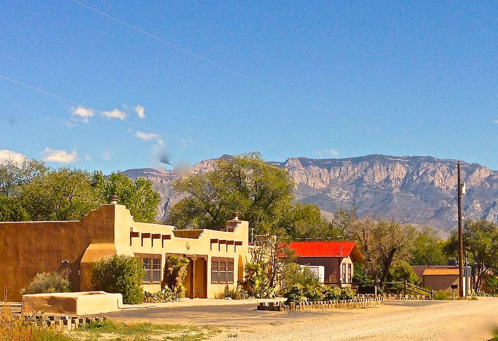 Front of Camino Encantado with Sandia Mountains in the background.