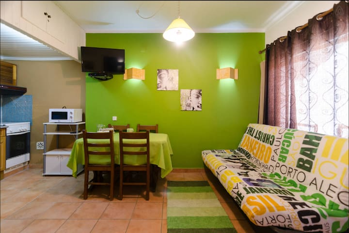 Apartment decorated with green colours in the living room