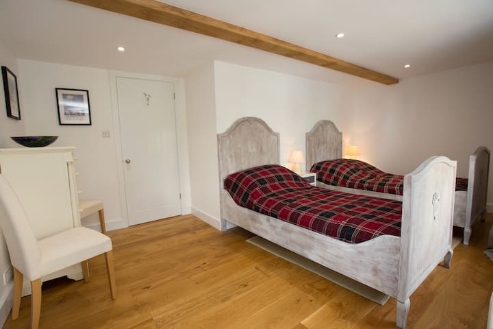 Twin Room - First Floor: -Single bed with new bedding x 2 - Bed lights x 2 - Bedside table x 2 - Set of drawers  - Clothes rack - Chairs x 2