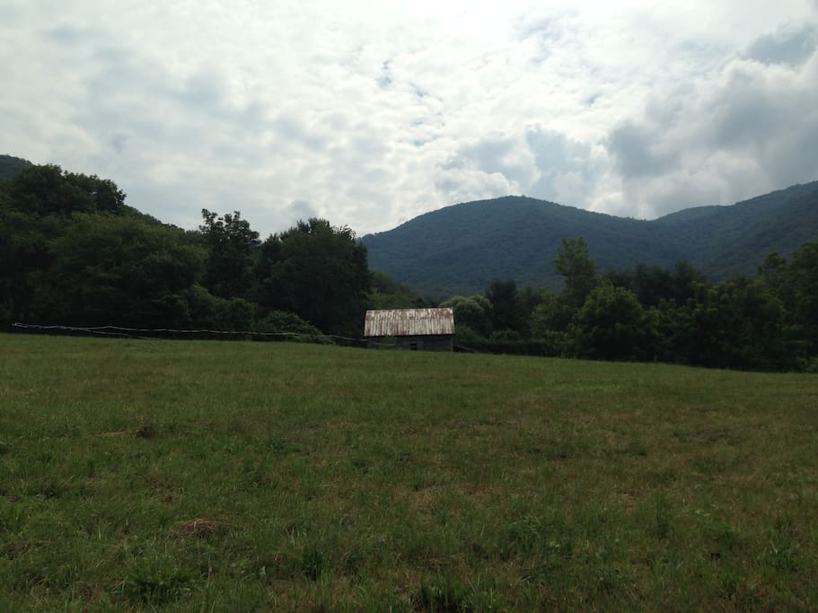 A field and barn in the community. Mountains in the background.