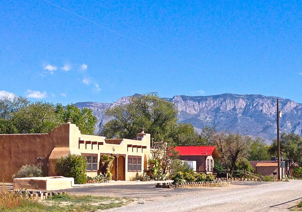 Camino Encantado Corrales home with Sandia Mountains in the background.