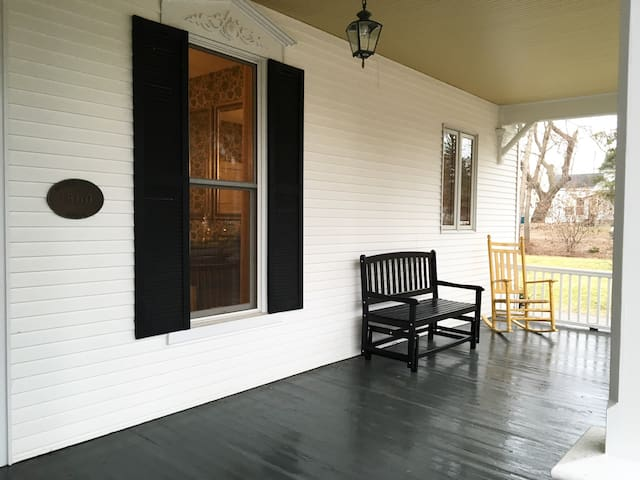 Large front porch for relaxing and chatting.