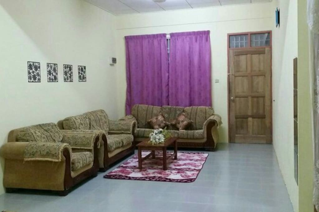 Living room view with sofa and coffee table. Very comfortable. Can acommadate more than 10 person.