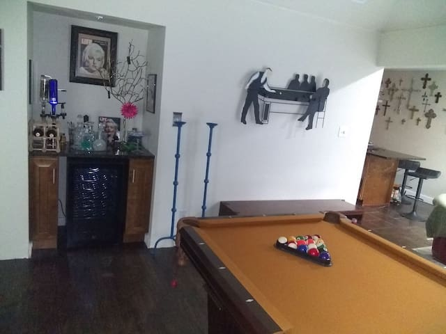 Bar, pool table and kitchen.
