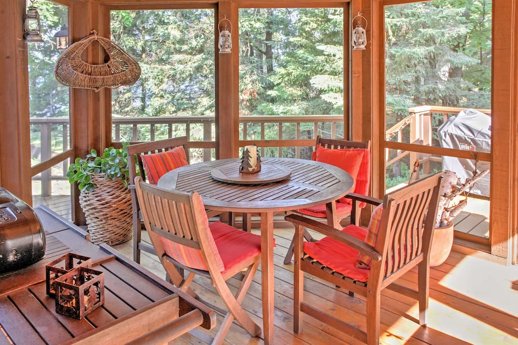 Take in the beautiful surroundings from this screened-in sun room!